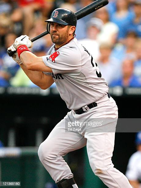 Jason Varitek of the Boston Red Sox drives the ball into left for a RBI single in the second inning at Kauffman Stadium on August 18 2011 in Kansas...