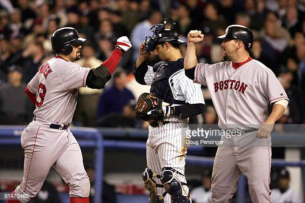 Jason Varitek of the Boston Red Sox is congratulated by teammate Trot Nixon after hittimg a tworun home run against the New York Yankees in the...