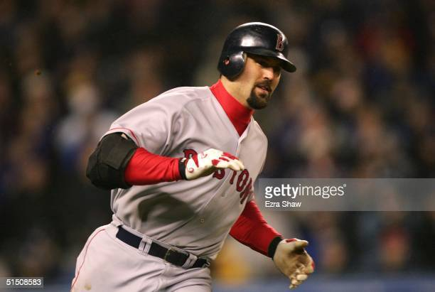 Jason Varitek of the Boston Red Sox reacts after hitting an RBI single in the forth inning against the New York Yankees of the Boston Red Sox during...