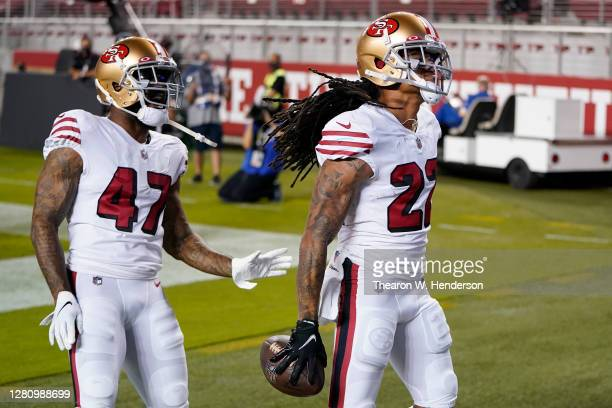 Jason Verrett is congratulated by teammate Jamar Taylor of the San Francisco 49ers after an interception in the end zone against the Los Angeles Rams...