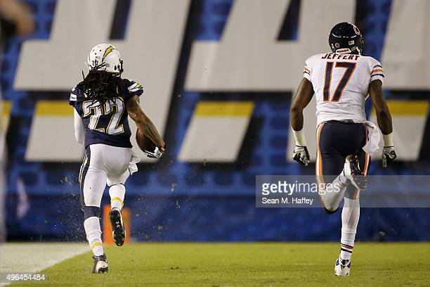 Jason Verrett of the San Diego Chargers runs back an interception for a touchdown while pursued by Alshon Jeffery of the Chicago Bears at Qualcomm...