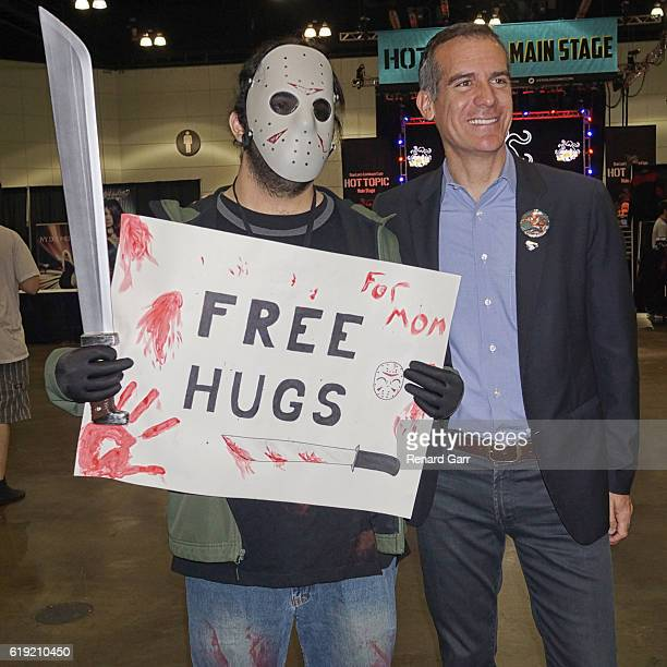 Jason Voorhees cosplayer and LA Mayor Eric Garcetti at Los Angeles Convention Center on October 29 2016 in Los Angeles California