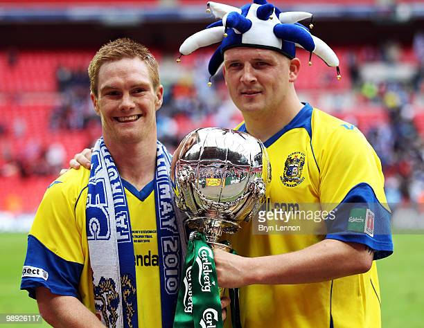 Jason Walker of Barrow celebrates with team mate Lee McEvilly after winning the FA Carlsberg Trophy Final between Barrow and Stevenage Borough at...