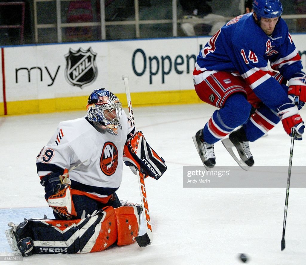 Jason Ward #14 of the New York Rangers jumps out of the way of a shot in front of Rick DiPietro #39 of the New York Islanders on April 11, 2006 at Madison Square Garden in New York City.