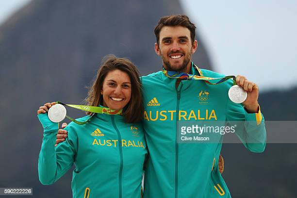 Jason Waterhouse of Australia and Lisa Darmanin of Australia celebrate winning the silver medal in the Nacra 17 Mixed class on Day 11 of the Rio 2016...