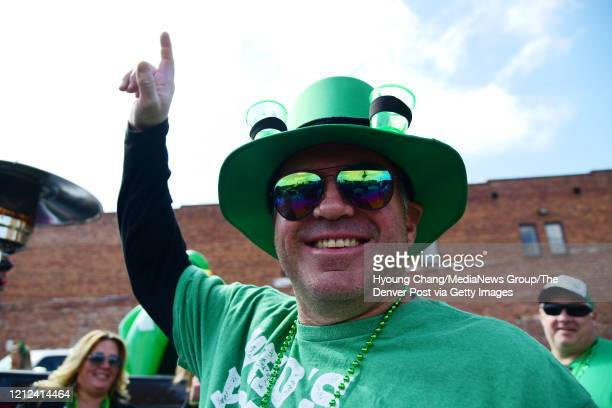 Jason Weingart is celebrating St Patricks Day with his family and friends at the empty parking of Lower Downtown in Denver Colorado on Saturday March...