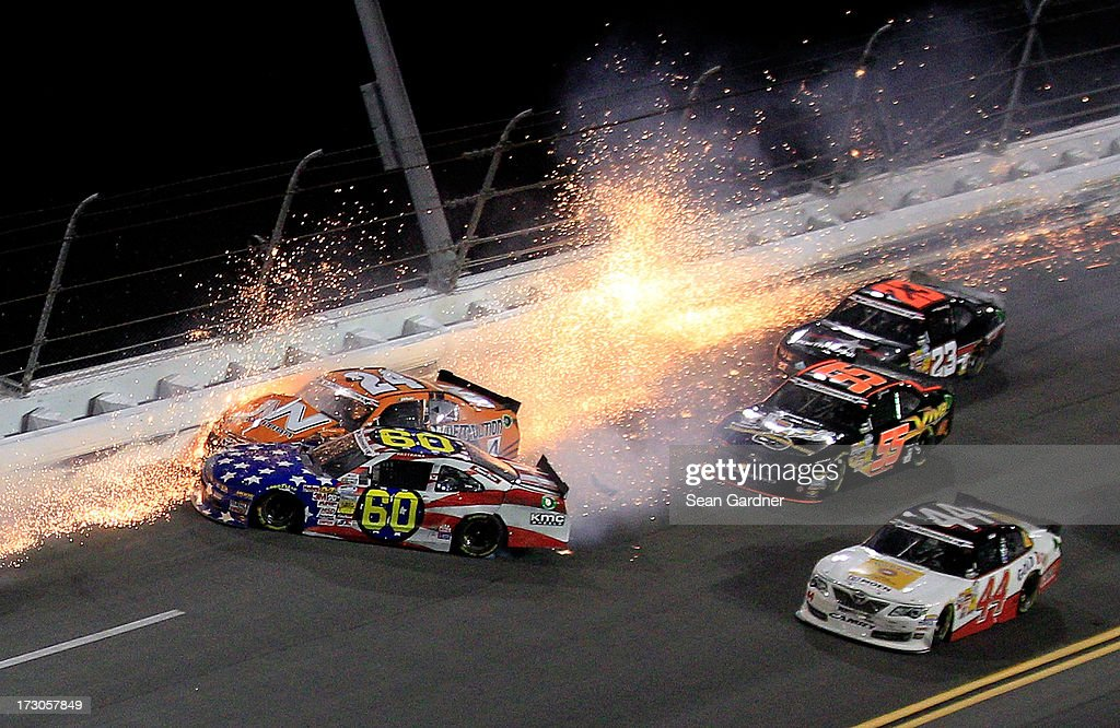 Jason White , driver of the #24 JW Demolition Toyota, crashes into Travis Pastrana, driver of the #60 Roush Fenway Racing / RaceTrac Ford, during the NASCAR Nationwide Series Subway Firecracker 250 at Daytona International Speedway on July 5, 2013 in Daytona Beach, Florida.