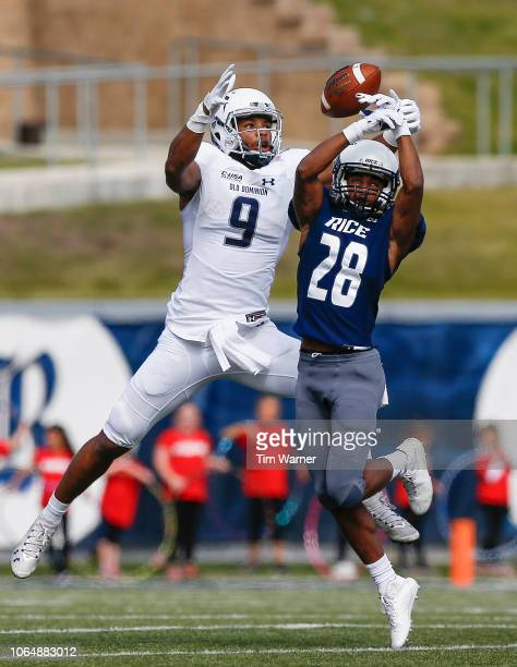 Jason White of the Rice Owls breaks up a pass intended for Jonathan Duhart of the Old Dominion Monarchs in the first half at Rice Stadium on November...