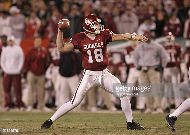 Jason White of the University of Oklahoma Sooners passes against the University of Colorado Buffaloes in the Big 12 Championship game on December 4...