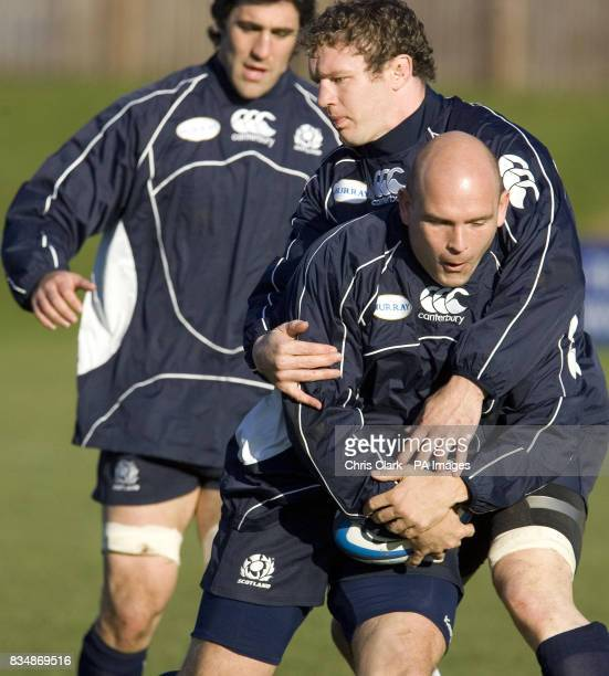 Jason White tackles Simon Webster during a training session at Watsonians' Myreside Stand Pitch Edinburgh