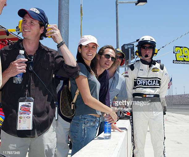 Jason Wiles JamieLynn DiScala and William Fichtner on pit road at the Auto Club 500 race on the California Speedway in Fontana May 2 2004