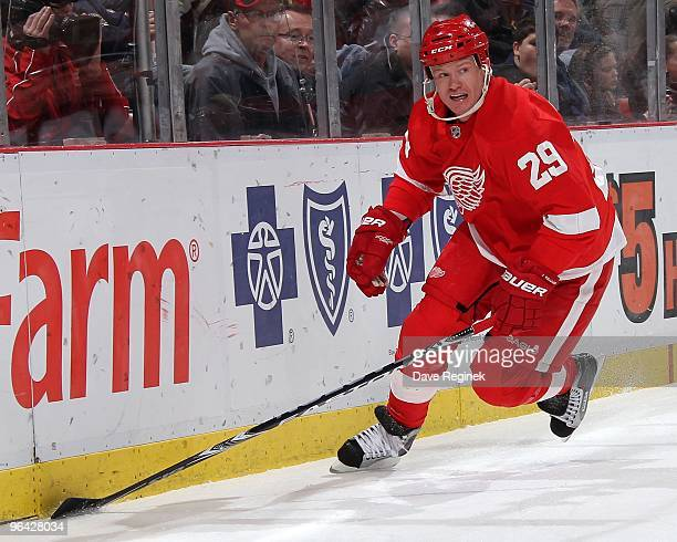 Jason Williams of the Detroit Red Wings skates alomg the boards during an NHL game against the Nashville Predators at Joe Louis Arena on January 29...