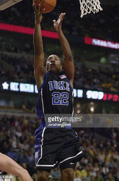Jason Williams of the Duke Blue Devils puts up a shot during the ACC/Big Ten Challenge against the Iowa Hawkeyes at United Center in Chicago Illinois...