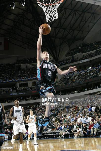 Jason Williams of the Memphis Grizzlies against the Dallas Mavericks on April 13 2004 at the American Airlines Center in Dallas Texas NOTE TO USER...