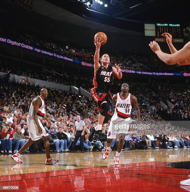 Jason Williams of the Miami Heat drives to the basket for a layup past Zach Randolph of the Portland Trail Blazers during a game at The Rose Garden...