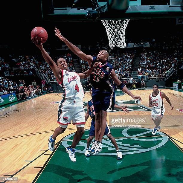 Jason Williams of the United States Select Team attempts a layup against Vin Baker of the United States National Team during a pre-Olympic exhibition...