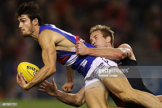Jason Winderlich of the Bombers tackles Easton Wood of the Bulldogs during the round seven AFL match between the Essendon Bombers and the Western...