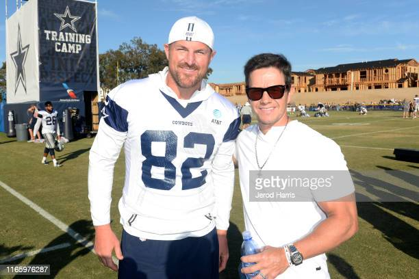Jason Witten and Mark Wahlberg attend The Dallas Cowboys Training Camp to Announce Wahlburgers Opening at The Star in Frisco on August 03 2019 in...