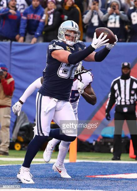 Jason Witten of the Dallas Cowboys catches a touchdown agains Brandon Dixon of the New York Giants in the fourth Quarter during their game at MetLife...