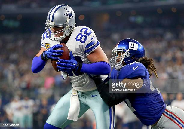 Jason Witten of the Dallas Cowboys catches a touchdown pass in front of Uani' Unga of the New York Giants in the fourth quarter at ATT Stadium on...