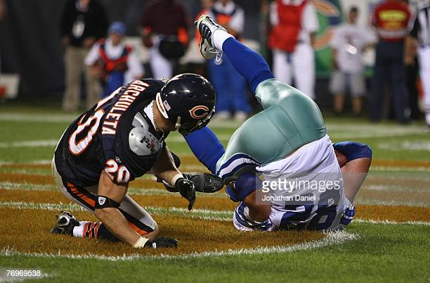 Jason Witten of the Dallas Cowboys catches a touchdown pass in the third quarter against Adam Archuleta of the Chicago Bears at Soldier Field on...