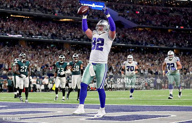 Jason Witten of the Dallas Cowboys celebrates after scoring the game winning touchdown against the Philadelphia Eagles in overtime at ATT Stadium on...