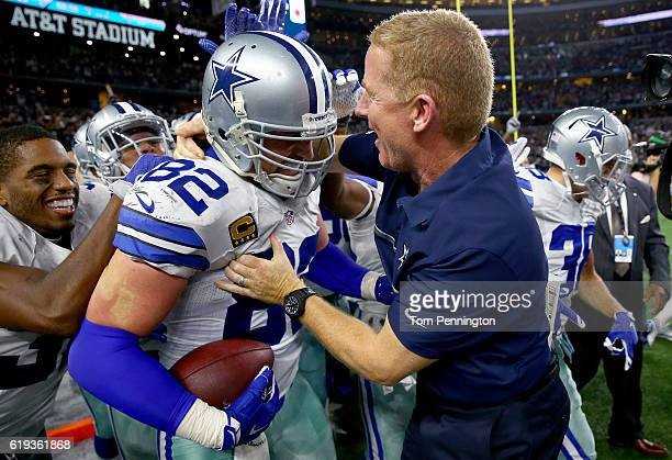 Jason Witten of the Dallas Cowboys celebrates with head coach Jason Garrett of the Dallas Cowboys after scoring the game winning touchdown against...