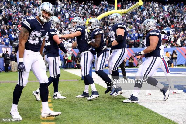 Jason Witten of the Dallas Cowboys celebrates with his teammates after scoring a 20 yard touchdown against the New York Giants in the fourth quarter...