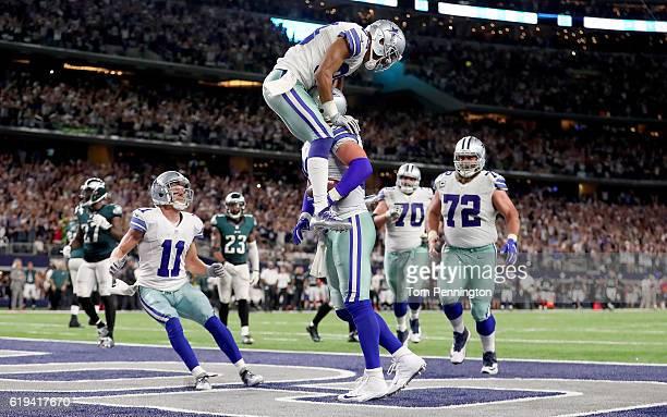 Jason Witten of the Dallas Cowboys celebrates with Terrance Williams of the Dallas Cowboys after scoring the game winning touchdown against the...