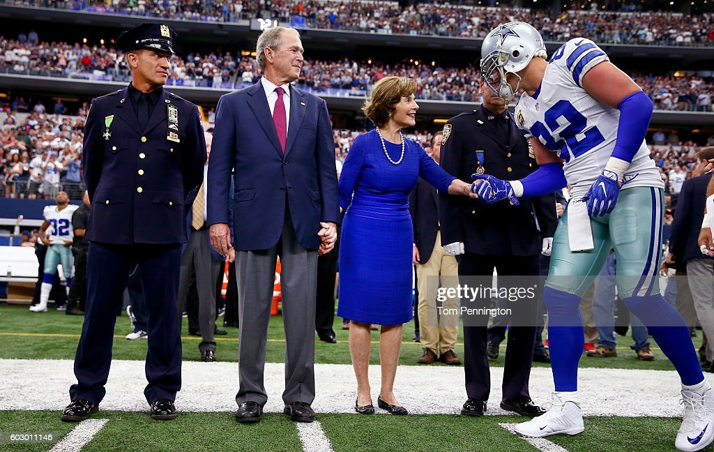 Jason Witten #82 of the Dallas Cowboys greets former First Lady Laura Bush and former U.S. President George W. Bush prior to the game against the New York Giants at AT&T Stadium on September 11, 2016 in Arlington, Texas.