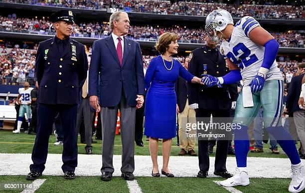 Jason Witten of the Dallas Cowboys greets former First Lady Laura Bush and former US President George W Bush prior to the game against the New York...