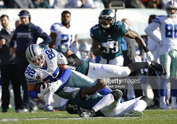 Jason Witten of the Dallas Cowboys is tackled by Jordan Hicks and Malcolm Jenkins of the Philadelphia Eagles after making a catch during the first...