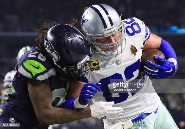 Jason Witten of the Dallas Cowboys is tackled by Shaquill Griffin of the Seattle Seahawks in the second half at ATT Stadium on December 24 2017 in...