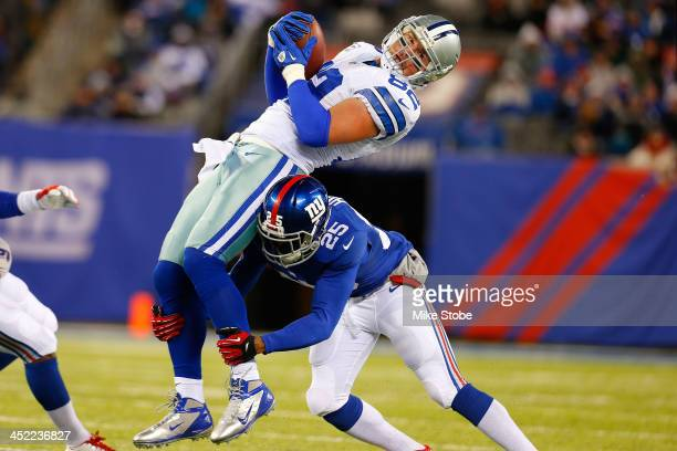 Jason Witten of the Dallas Cowboys is tackled by Will Hill of the New York Giants at MetLife Stadium on November 24 2013 in East Rutherford New...