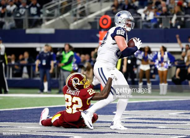 Jason Witten of the Dallas Cowboys makes a touchdown pass reception against Deshazor Everett of the Washington Redskins in the second quarter at ATT...