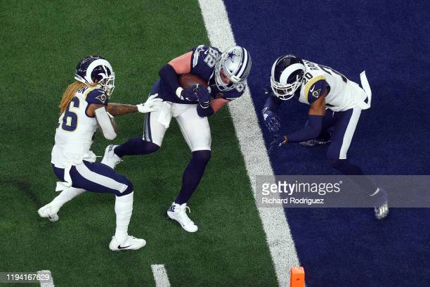 Jason Witten of the Dallas Cowboys runs into the end zone against Marqui Christian of the Los Angeles Rams and Jalen Ramsey of the Los Angeles Rams...