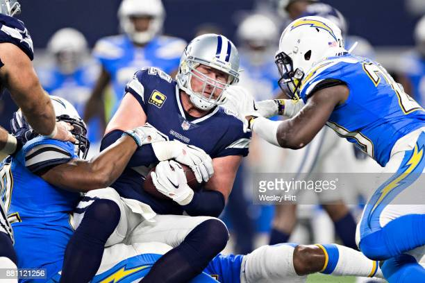 Jason Witten of the Dallas Cowboys runs the ball after catching a pass during a game against the Los Angeles Chargers at ATT Stadium on November 23...