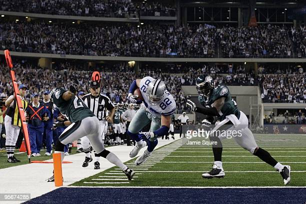 Jason Witten of the Dallas Cowboys runs towards the endzone for 18yards and is tackled at the oneyardline in the second quarter against the...