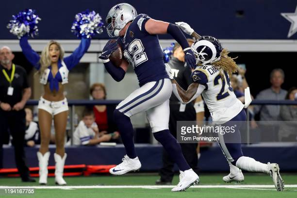 Jason Witten of the Dallas Cowboys scores a touchdown against Marqui Christian of the Los Angeles Rams in the first half at ATT Stadium on December...