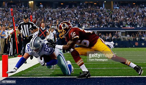 Jason Witten of the Dallas Cowboys scores a touchdown as Bashaud Breeland of the Washington Redskins is unable to prevent the score during the second...