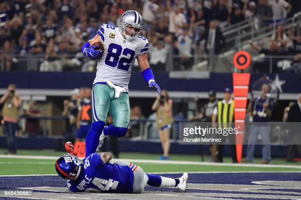 Jason Witten of the Dallas Cowboys scores a touchdown over Eli Apple of the New York Giants in the first half of a game at ATT Stadium on September...