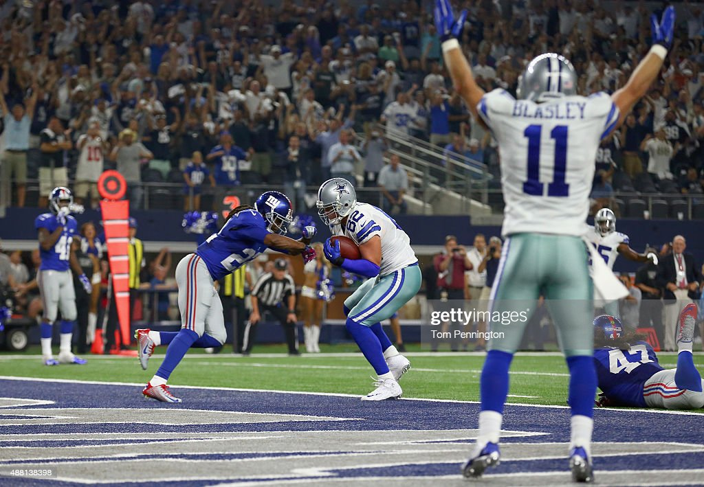 Jason Witten #82 of the Dallas Cowboys scores the game tying touchdown against Brandon Meriweather #22 of the New York Giants at AT&T Stadium on September 13, 2015 in Arlington, Texas.