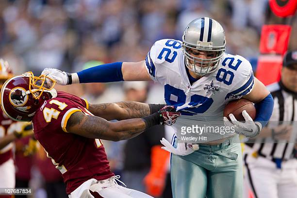 Jason Witten of the Dallas Cowboys stiff arms Kareem Moore of the Washington Redskins at Cowboys Stadium on December 19 2010 in Arlington Texas The...