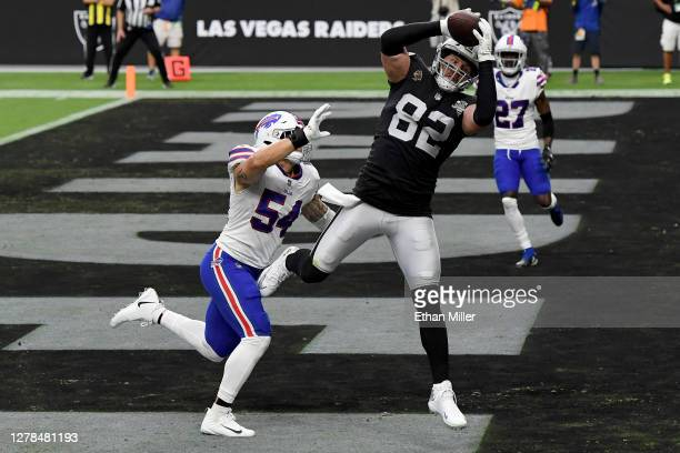 Jason Witten of the Las Vegas Raiders catches a 3yard touchdown pass thrown by Derek Carr against AJ Klein of the Buffalo Bills during the second...