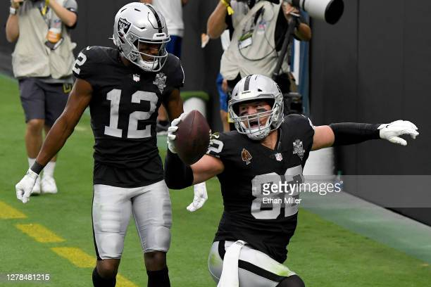Jason Witten of the Las Vegas Raiders celebrates with Zay Jones after catching a 3yard touchdown pass thrown by Derek Carr against the Buffalo Bills...