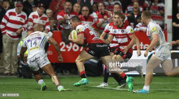 Jason Woodward of Gloucester breaks clear to score the last minute match winning try during the Aviva Premiership match between Gloucester Rugby and...