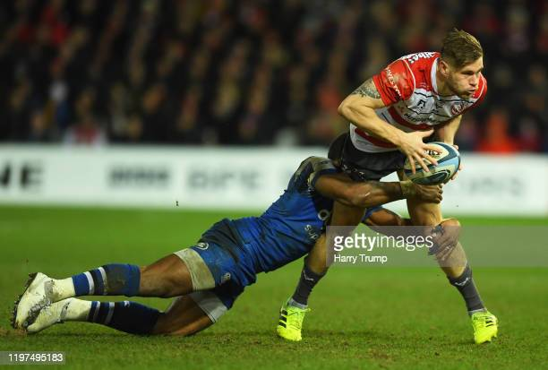 Jason Woodward of Gloucester Rugby is tackled by Semesa Rokoduguni of Bath Rugby during the Gallagher Premiership Rugby match between Gloucester...
