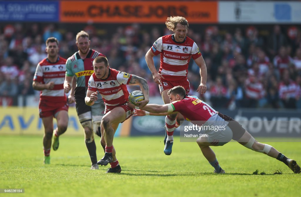 Jason Woodward of Gloucester runs past Dave Lewis of Harlequins during the Aviva Premiership match between Gloucester Rugby and Harlequins at Kingsholm Stadium on April 14, 2018 in Gloucester, England.