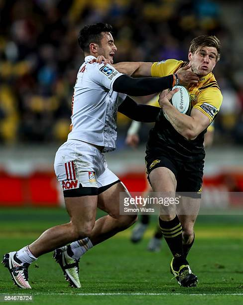 Jason Woodward of the Hurricanes looks to break a tackle during the Super Rugby Semi Final match between the Hurricanes and the Chiefs at Westpac...