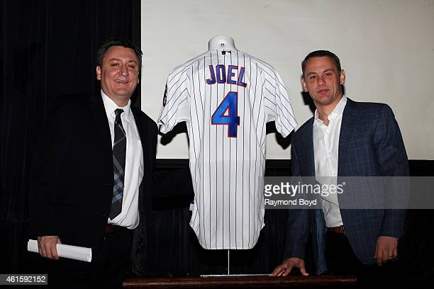 Jason Wright of Live Nation and Jed Hoyer, Executive Vice-President and General Manager of the Chicago Cubs poses for photos at the Cubby Bear after...